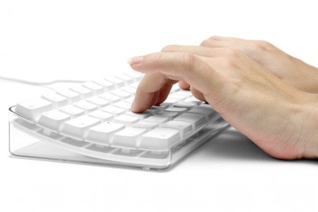 Hands on a White Computer Keyboard